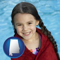 alabama map icon and a little girl wrapped in a dark red towel, in front of a swimming pool