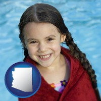 arizona map icon and a little girl wrapped in a dark red towel, in front of a swimming pool