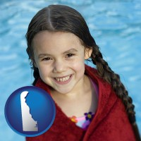 delaware map icon and a little girl wrapped in a dark red towel, in front of a swimming pool