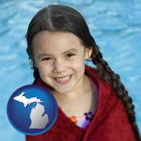 michigan map icon and a little girl wrapped in a dark red towel, in front of a swimming pool