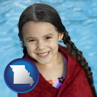 missouri map icon and a little girl wrapped in a dark red towel, in front of a swimming pool