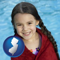 new-jersey map icon and a little girl wrapped in a dark red towel, in front of a swimming pool
