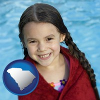 south-carolina map icon and a little girl wrapped in a dark red towel, in front of a swimming pool