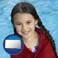 south-dakota map icon and a little girl wrapped in a dark red towel, in front of a swimming pool