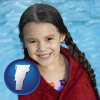 vermont map icon and a little girl wrapped in a dark red towel, in front of a swimming pool