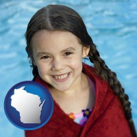 wisconsin map icon and a little girl wrapped in a dark red towel, in front of a swimming pool